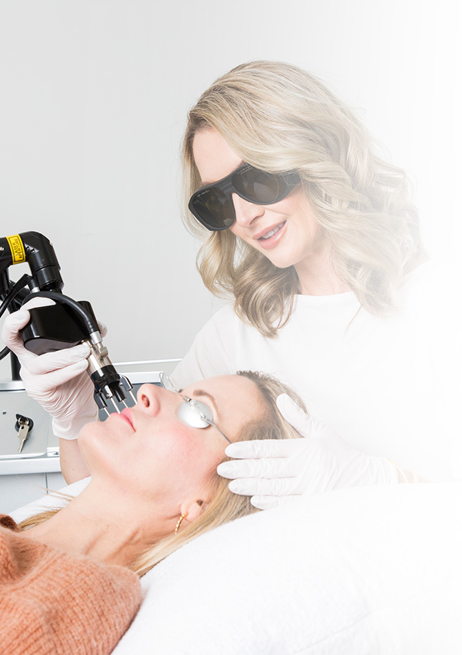 Nadine Sabino giving laser treatment to a patient
